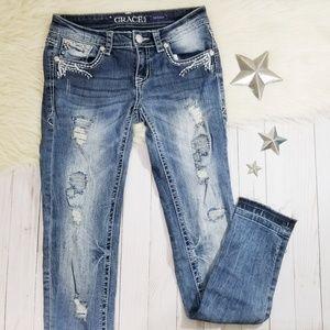 Grace in LA skinny jeans fray hem distressed bling